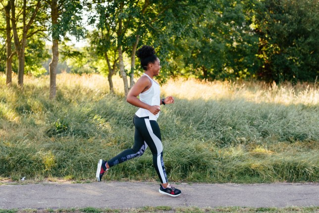 Elle Linton running outdoors in a park