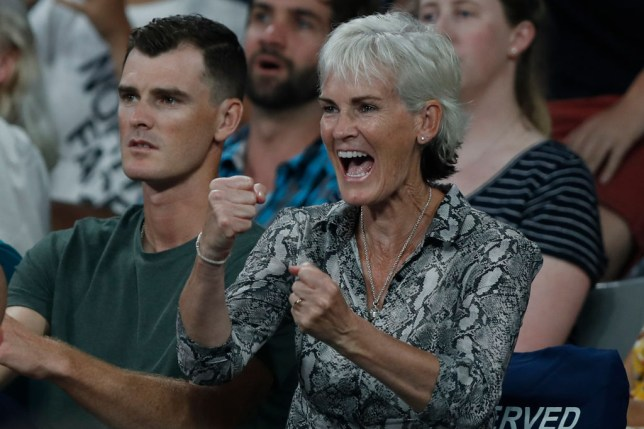Judy Murray celebrates a point while watching Andy Murray in action