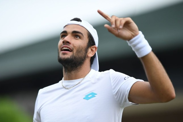 Matteo Berrettini celebrates setting up a meeting with Roger Federer