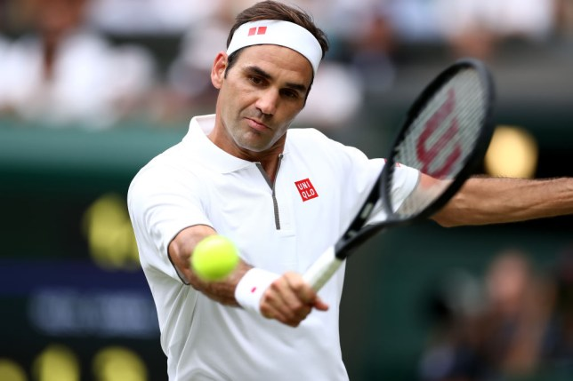 Roger Federer hits a backhand at Wimbledon