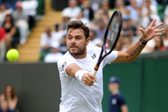 Stan Wawrinka hits a backhand at Wimbledon