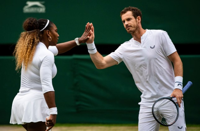 Serena Williams and Andyr Murray high five on Centre Court at Wimbledon