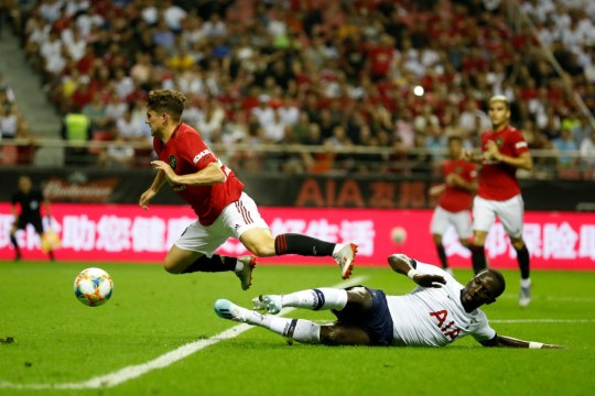 Daniel James is fouled by Tottenham midfielder Moussa Sissoko