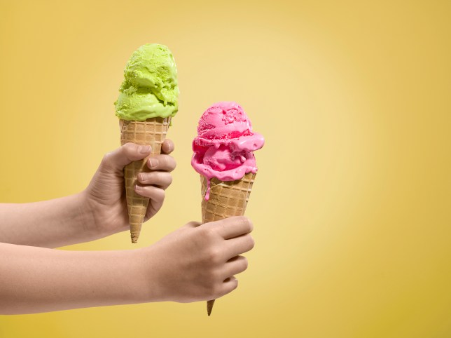 Two hands holding ice cream