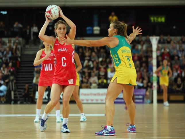 Sara Bayman playing netball for England against Australia