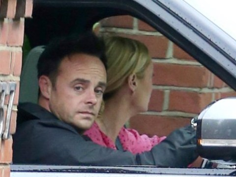 Ant McPartlin looks sombre as he gets back behind the wheel after 15-month driving ban