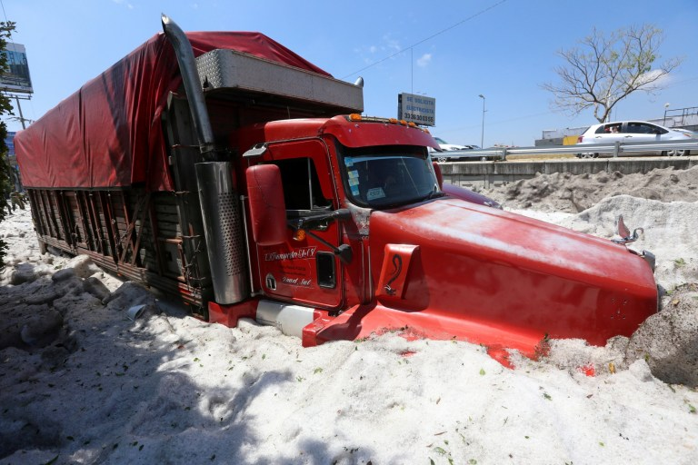 A truck is buried in ice after a heavy storm of rain and hail which affected some areas of the city in ??????Guadalajara, Mexico June 30, 2019. REUTERS/Fernando Carranza