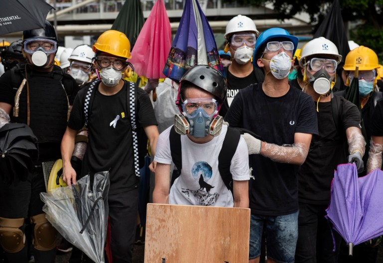 SIPA USA via PA Images Anti government protesters seen equipped with gas masks and umbrellas to protect themselves from possible tear gas and pepper spray usage by the police. Thousands of anti government protesters faced off with riot police and occupy major roads around the Hong Kong government complex during the 22nd anniversary of Hong Kong return to Chinese rule. (Photo by Miguel Candela / SOPA Images/Sipa USA)