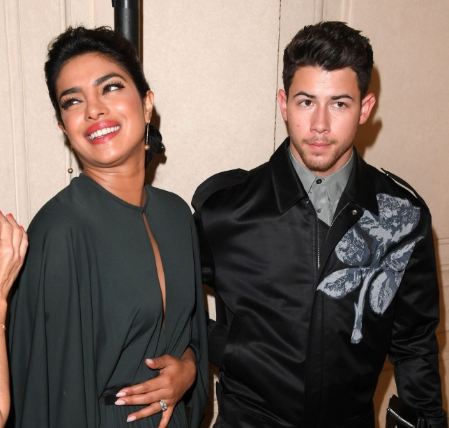 Mandatory Credit: Photo by David Fisher/REX (10325498ac) Priyanka Chopra (holding her tummy) and Nick Jonas in the front row Christian Dior show, Front Row, Fall Winter 2019, Haute Couture Fashion Week, Paris, France - 01 Jul 2019