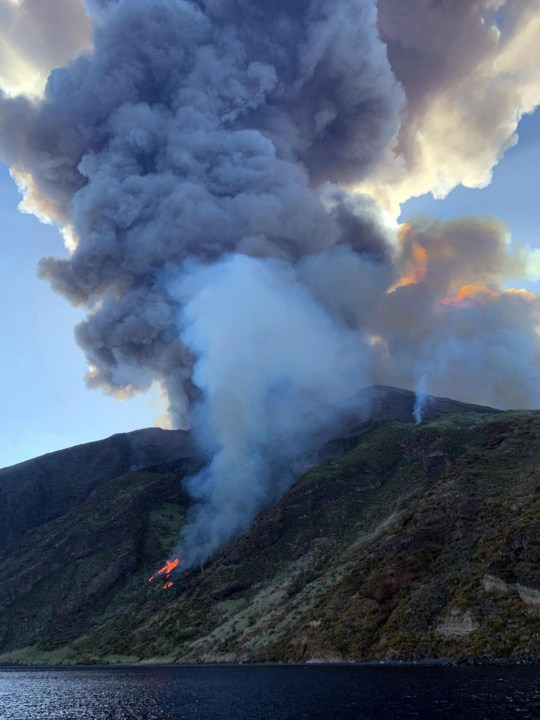 epa07692559 Ash rises into the sky after a volcano eruption on a small island of Stromboli, Italy, 03 July 2019. According to reports, the island of Stromboli was hit by a set of violent volcano eruptions spurring beach tourists to take into the sea. Two new lava spouts are creeping down the volcano. EPA/MARIO CALABRESI / TWITTER EDITORIAL USE ONLY/NO SALES
