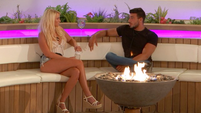 Lucie and Tommy by the firepit in Love Island
