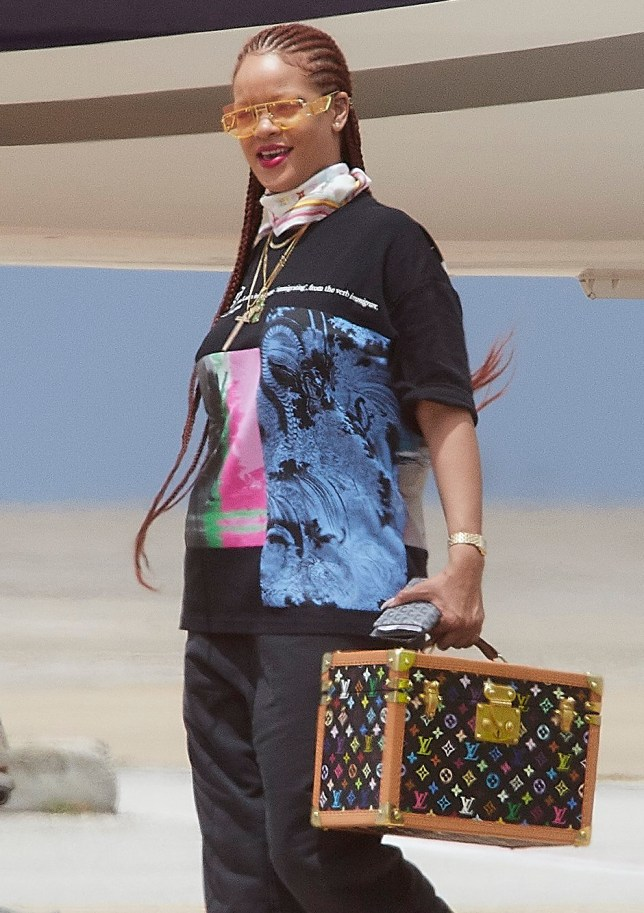 Rihanna proves why she is a fashion icon as she steps off of her private jet flight in Bridgetown, Barbados. Adorned in lots of gold jewelry, while wearing (surprisingly) Louis Vuitton bag, and topping off her look with her newly launched Fenty eyewear, she is all smiles as she visits Barbados in preparation for her best friend Sonita's delivery of her baby. Pictured: Ref: SPL5102142 040719 NON-EXCLUSIVE Picture by: Kyle Babb / SplashNews.com Splash News and Pictures Los Angeles: 310-821-2666 New York: 212-619-2666 London: 0207 644 7656 Milan: 02 4399 8577 photodesk@splashnews.com World Rights,
