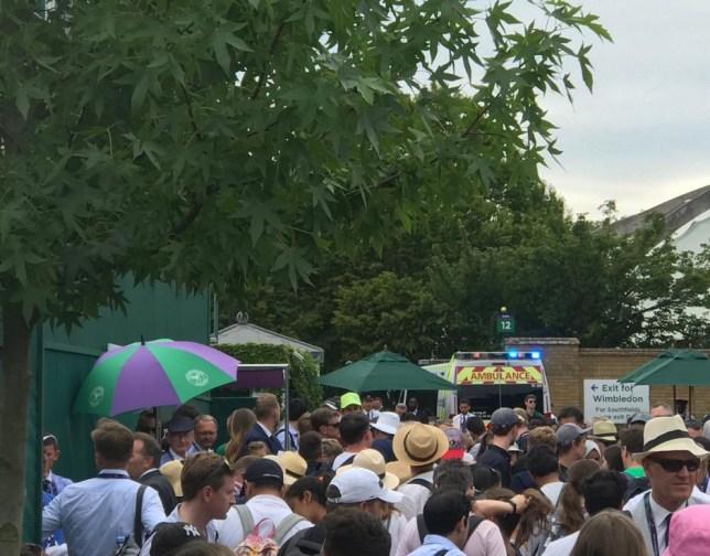 Wimbledon fan taken away in ambulance