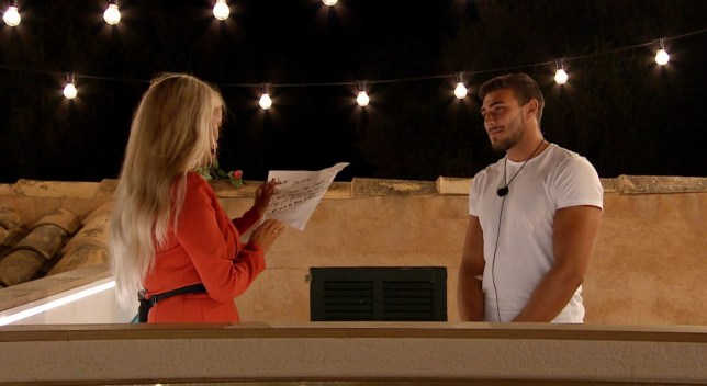 Editorial Use Only. No Merchandising. No Commercial Use. Mandatory Credit: Photo by ITV/REX (10330104af) Tommy Fury gives Molly-Mae Hague the message 'Love Island' TV Show, Series 5, Episode 31, Majorca, Spain - 08 Jul 2019 Highlights include: ANNA?S BIRTHDAY PARTY IS INTERRUPTED BY A DUMPING AND A SHOCK TWIST ANTON AND BELLE GET CHEESY ON THEIR FIRST DATE TOMMY ASKS MOLLY-MAE TO BE HIS GIRLFRIEND THE ISLANDERS BECOME AWARE OF MAURA?S FEELINGS FOR CURTIS