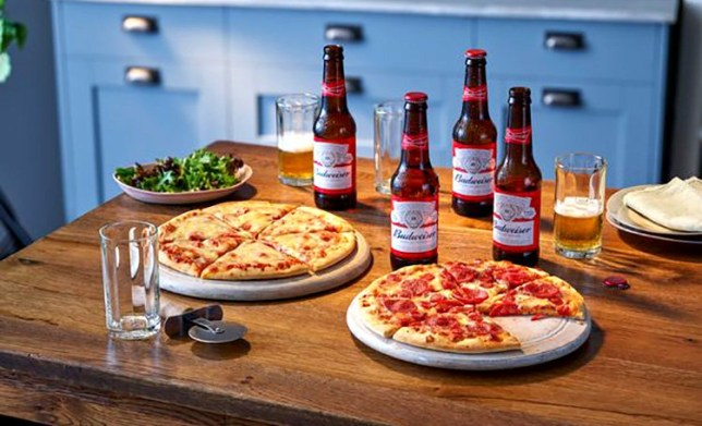 Two pizzas and four beers, an offer being sold by Co-op