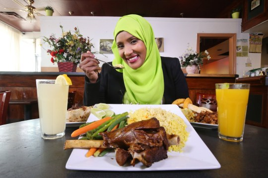 TORONTO, ON - SEPTEMBER 22 - - Local TV host Hodan Nalayeh poses for pictures with a table full of Somolian food at Bilal restaurant in Rexdale. (Vince Talotta/Toronto Star via Getty Images)
