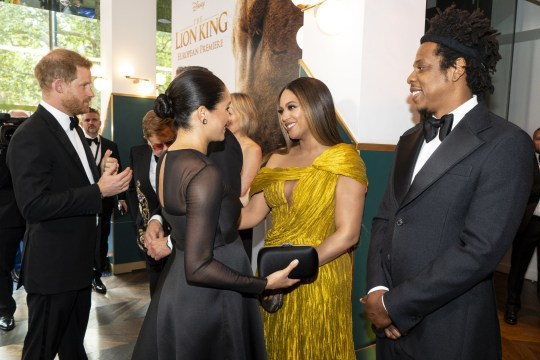 """LONDON, ENGLAND - JULY 14: Prince Harry, Duke of Sussex (L) and Meghan, Duchess of Sussex (2nd L) meets cast and crew, including Beyonce Knowles-Carter (C) Jay-Z (R) as they attend the European Premiere of Disney's """"The Lion King"""" at Odeon Luxe Leicester Square on July 14, 2019 in London, England. (Photo by Niklas Halle'n-WPA Pool/Getty Images)"""