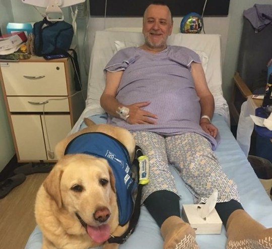 Hospital bosses have apologised after banning a blind man from bringing his guide dog to dialysis appointments. Mark Burchell has been receiving the life saving kidney treatment three times a week since December. Image shows Mr Burchell and dog Judi.