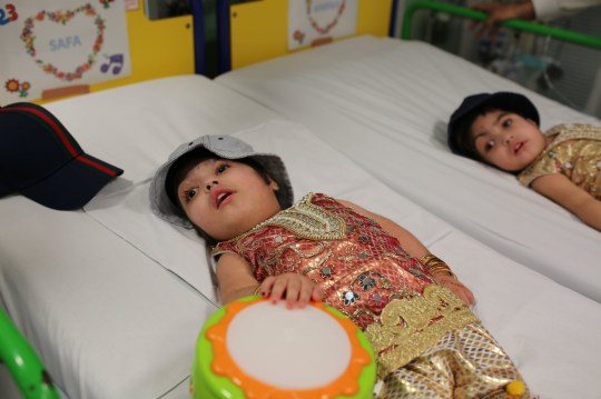 Undated handout photo issued by Great Ormond Street Hospital of two-year-olds Safa and Marwa Ullah, from Charsadda in Pakistan, after a surgery to separate their heads at the hospital in London. PRESS ASSOCIATION Photo. Issue date: Monday July 15, 2019. The sisters, who were craniopagus twins, underwent three major operations to separate their heads at Great Ormond Street. The last operation, which saw the girls finally separated, took place on February 11 this year. See PA story HEALTH Twins. Photo credit should read: Great Ormond Street Hospital/PA Wire NOTE TO EDITORS: This handout photo may only be used in for editorial reporting purposes for the contemporaneous illustration of events, things or the people in the image or facts mentioned in the caption. Reuse of the picture may require further permission from the copyright holder.