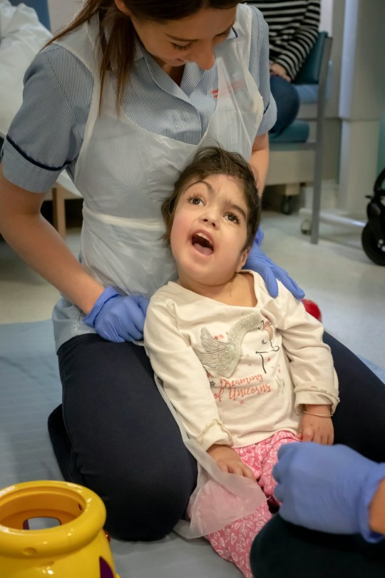 Twin Marwa having physio. The surgeons behind the life-changing separation of a set of craniopagus conjoined twins at London???s Great Ormond Street Hospital are launching a new charity today ??? Gemini Untwined ??? to support similar pioneering operations in the future