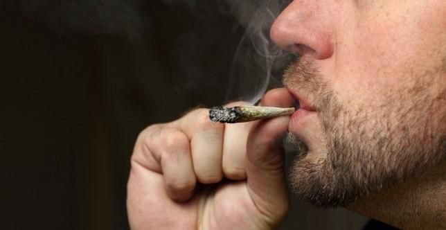 A shot of a man smoking pot