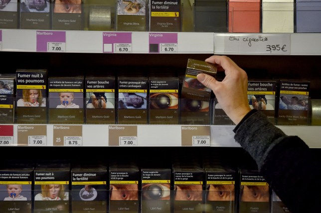 A tobacconist sells plain cigarette packages in a tobacco shop in Vertou, western France, on December 27, 2016. Tobacconists in France will only be permitted to sell plain tobacco packages as of January 1, 2017. / AFP / LOIC VENANCE (Photo credit should read LOIC VENANCE/AFP/Getty Images)