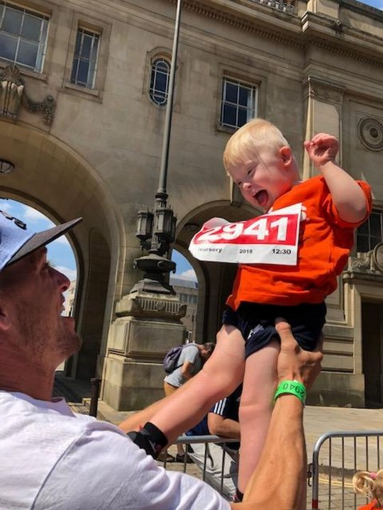 Lincoln Fay, four, was cheered on by crowds as he took part in a fun run in Bolton