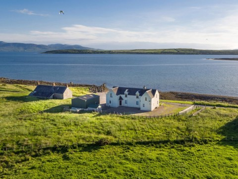 A 660-acre Scottish island with its own farmhouse and ferry is up for sale