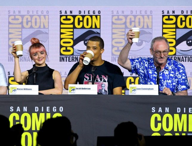 """SAN DIEGO, CALIFORNIA - JULY 19: (L-R) Maisie Williams, Jacob Anderson, and Liam Cunningham speak at the """"Game Of Thrones"""" Panel And Q&A during 2019 Comic-Con International at San Diego Convention Center on July 19, 2019 in San Diego, California. (Photo by Kevin Winter/Getty Images)"""