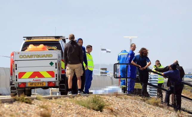 A view of the scene in Camber, East Sussex, as emergency services attend an accident thought to involve a kite surfer. PRESS ASSOCIATION Photo. Picture date: Saturday July 20, 2019. A man has died after falling onto a wall at a beach along the south-east coast of England. Police were called to Camber Sands near Rye on Saturday morning and the victim was pronounced dead at the scene