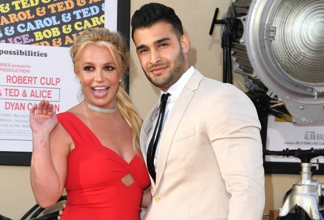 """HOLLYWOOD, CALIFORNIA - JULY 22: Britney Spears and Sam Asghari arrives at the Sony Pictures' """"Once Upon A Time...In Hollywood"""" Los Angeles Premiere on July 22, 2019 in Hollywood, California. (Photo by Steve Granitz/WireImage)"""