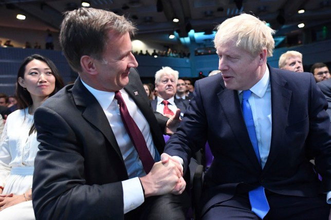 "Jeremy Hunt, left, congratulates Boris Johnson after the announcement of the result in the ballot for the new Conservative party leader, in London, Tuesday, July 23, 2019. Brexit hardliner Boris Johnson won the contest to lead Britain's governing Conservative Party on Tuesday and will become the country's next prime minister, tasked with fulfilling his promise to lead the U.K. out of the European Union ""come what may."" (Stefan Rousseau/Pool photo via AP)"
