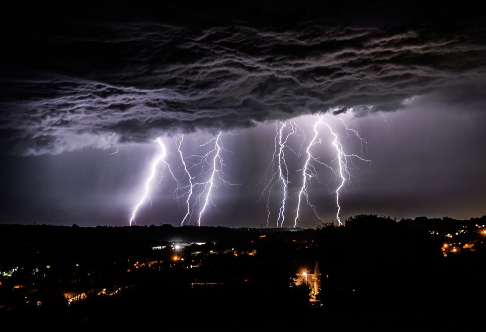 Picture by Paul Slater/PSI - Copyrighted Image - No resale or transfer to 3rd parties without prior consent from Copyright Owner Contact 07512838472. PICTURE CAPTION. - Multiple exposure of lightning strikes pictured over Plymouth as seen from Ivybridge.