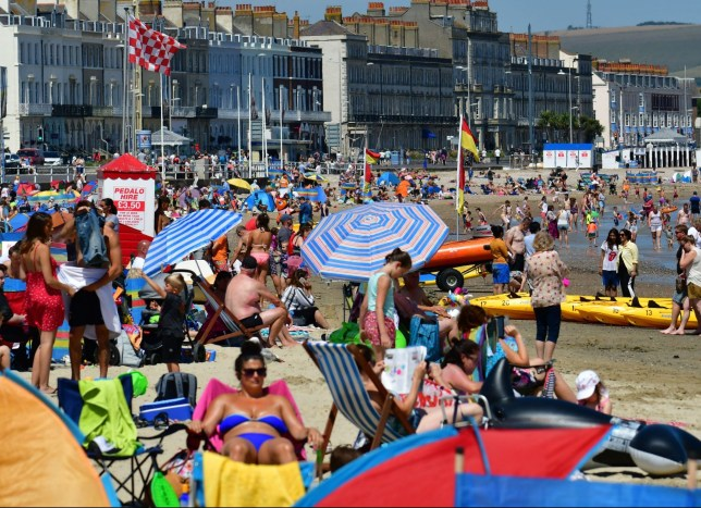 Mandatory Credit: Photo by Robert Timoney/REX (10346219c) Heatwave, record temperatures with people in the sea and on the seafront at Weymouth in Dorset. Seasonal Weather, UK - 24 Jul 2019