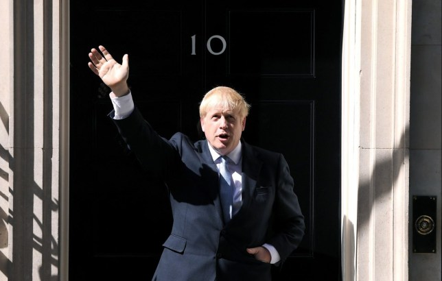 Mandatory Credit: Photo by James Veysey/REX (10345932bq) Boris Johnson waves outside number 10 after delivering his first speech as Prime Minister in Downing Street Prime Ministerial handover, London, UK - 24 Jul 2019
