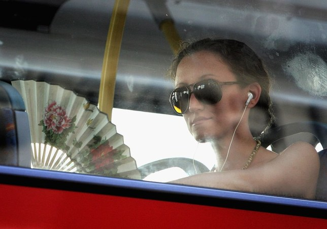 LONDON - JULY 18: A woman on a bus fans herself to keep cool on July 18, 2006 in London, England. Temperatures soared across Britain on what may turn out to be one of the hottest days on record. (Photo by Chris Jackson/Getty Images)