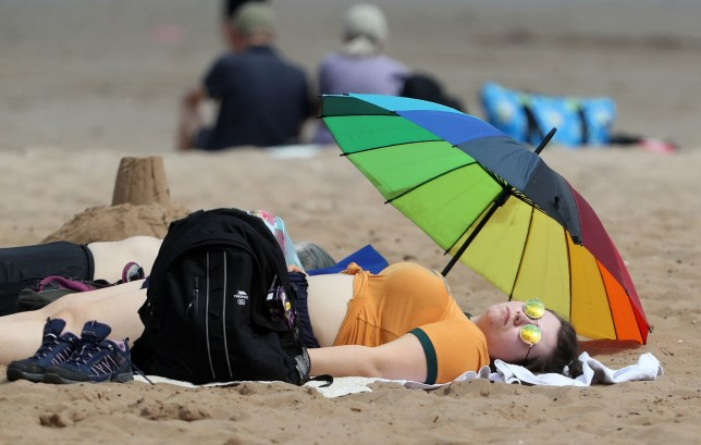 People on Portobello beach near Edinburgh. PRESS ASSOCIATION Photo. Picture date: Friday July 26, 2019. The Met Office said a new record temperature for the month was set at 38.1C (100.6F) in Cambridge on Thursday afternoon, beating the previous record of 36.7C (98.1F) set at Heathrow in 2015. See PA story WEATHER Hot. Photo credit should read: Andrew Milligan/PA Wire
