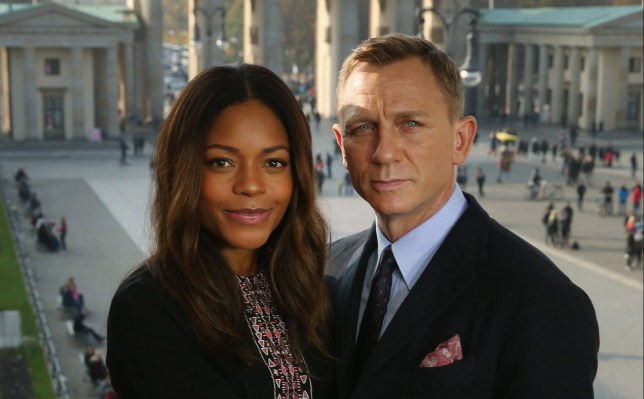 BERLIN, GERMANY - OCTOBER 28: (EXCLUSIVE COVERAGE) Naomie Harris and Daniel Craig pose with the Brandenburg Gate behind during a photocall prior the German premiere of the new James Bond movie 'Spectre' at Hotel Adlon on October 28, 2015 in Berlin, Germany. (Photo by Sean Gallup/Getty Images for Sony Pictures)