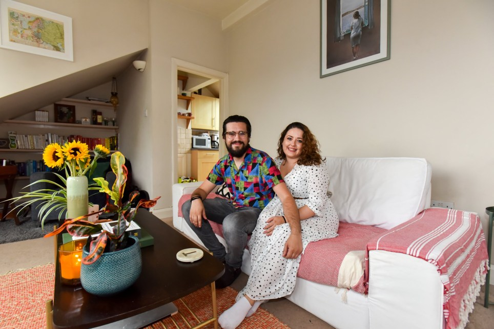 what I rent Tessa and dan in Muswell Hill, couple sitting on sofa in living room