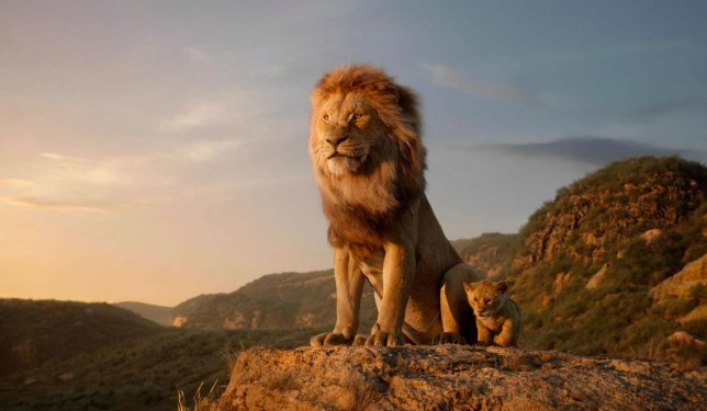 "This image released by Disney shows characters, from left, Mufasa, voiced by James Earl Jones, and young Simba, voiced by JD McCrary, in a scene from ""The Lion King."" (Disney via AP)"