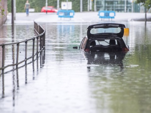 Half a month's rain in 24 hours floods UK as heatwave turns to washout