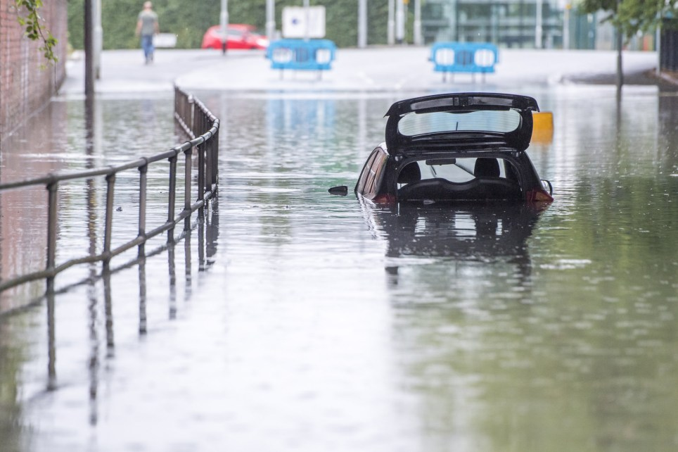 MANCHESTER, ENGLAND - JULY 28: A car is trapped in flood water on Crossley Road near Levenshulme following heavy rainfall overnight on July 28, 2019 in Manchester, England. (Photo by Anthony Devlin/Getty Images)