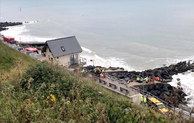 Fire officers are cutting through a rock to rescue a man trapped while the tide comes in with the water up to his neck, the Coastguard has said. Cromer and Sheringham Coastguard Rescue Teams were sent along with Sheringham RNLI Lifeboat, Norfolk Fire & Rescue Service, Norfolk Police and East of England Ambulance Service