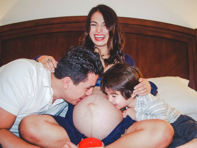 Julieta Torres pictured with her husband and eldest son while she was pregnant
