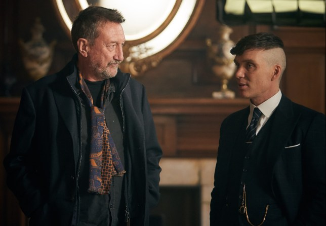 Steven Knight (writer/creator) and Cillian Murphy (Tommy Shelby) on the set of Peaky Blinders | Series 5 (BBC One) | Episode 01 | behind-the-scenes Photographer: Robert Viglasky © Caryn Mandabach Productions Ltd. 2019