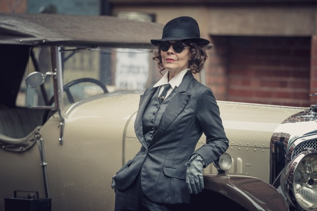Peaky Blinders Polly, played by helen mccrory, poses against a car