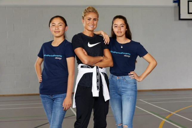 Steph Houghton stands with two teenage girls