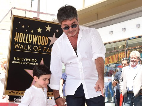 Simon Cowell's son is harshest critic as he asks dad why he can't flex pecs like Terry Crews