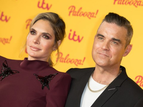 Robbie Williams and Ayda Field 'to spend daughter's first birthday with her surrogate mum'