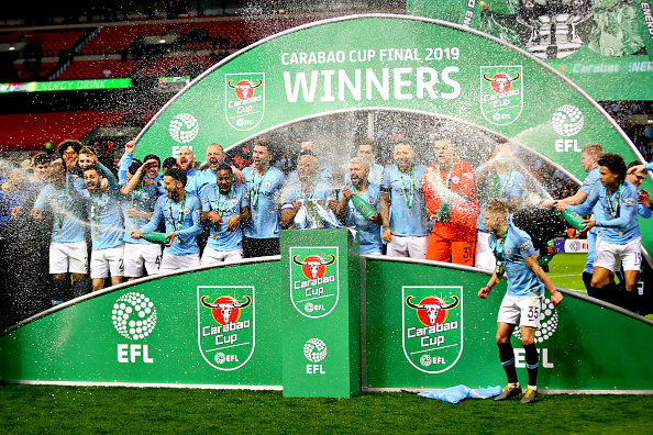 The Manchester City team celebrate with the trophy after they won the Carabao Cup Final